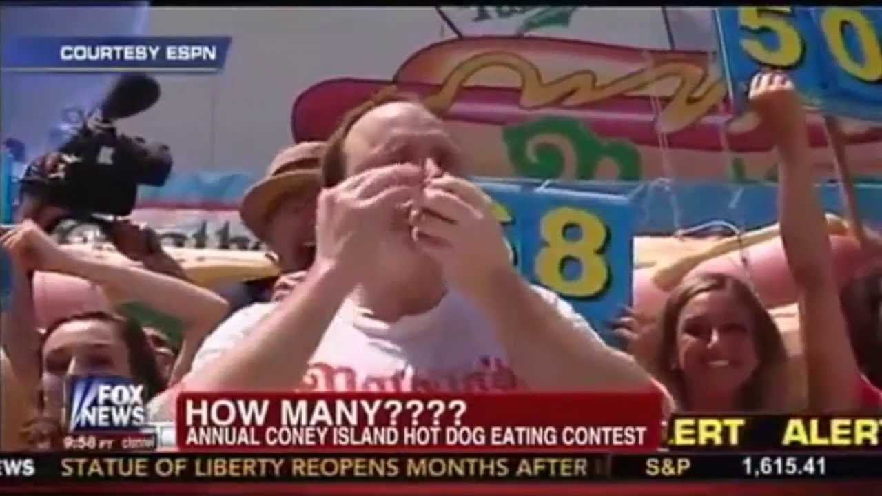 Man Sets New Record In Hot Dog Eating Contest