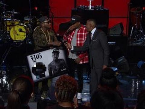 Jeezy Presents YG With A Platinum Plaque