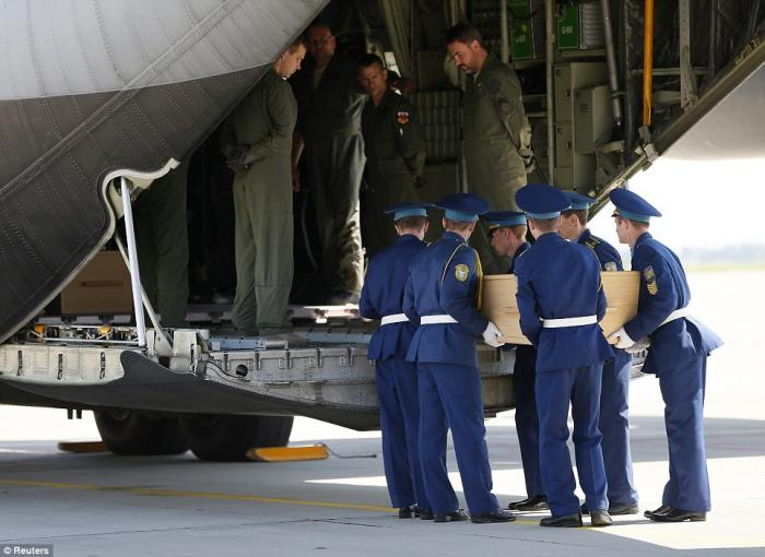 Malaysian Airlines MH17 Victims Being Transported From The Airport One At A Time