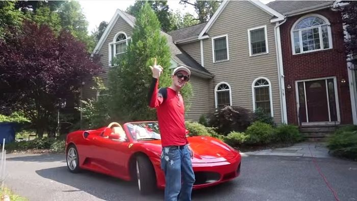 Jamie_Lewis_shows_his_new_ride_A_red_Ferrari_convertible_Catch_Fail