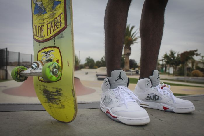 Skateboarding In Supreme x Jordan 5's